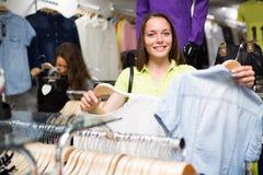 Woman choosing cloths in shop Stock Photos