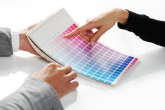 Woman Choosing color. From color scale Stock Image