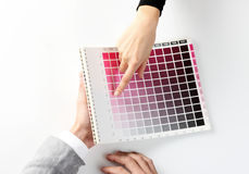 Woman Choosing color from color scale Stock Photography