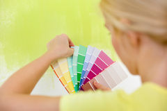 Woman choosing color for wall. Woman choosing color for painting wall Stock Images