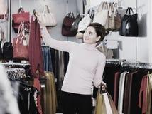 Woman choosing colorful blouse Stock Image