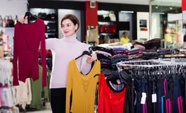 Woman choosing colorful blouse Royalty Free Stock Photography