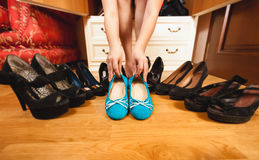 Woman choosing comfortable flats rather than high heels Royalty Free Stock Photos