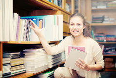 Woman choosing copy-books Royalty Free Stock Image