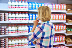 Woman choosing dairy products. In shop Stock Photography