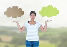 Woman choosing or deciding clouds with open palm hands Stock Image