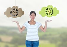 Woman choosing or deciding clouds of time or money with open palm hands. Digital composite of Woman choosing or deciding clouds of time or money with open palm Stock Images