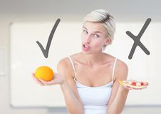 Woman choosing or deciding food with open palm with tick and X right or wrong. Digital composite of Woman choosing or deciding food with open palm with tick and Stock Photos