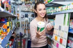 Woman choosing decorating paint Stock Images