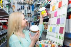 Woman choosing decorating paint Stock Photo