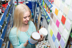 Woman choosing decorating paint Stock Image