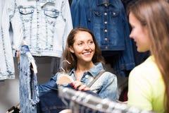 Woman choosing denim jacket in shop Royalty Free Stock Photo
