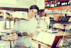 Woman choosing dessert Stock Images