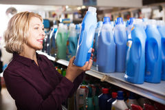 Woman choosing detergent in shop Royalty Free Stock Photo