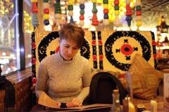 Woman choosing dish Stock Images