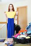 Woman choosing dress for rest Royalty Free Stock Photos