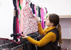 Woman choosing dress at  store Stock Images