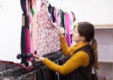 Woman choosing dress at  store Stock Images