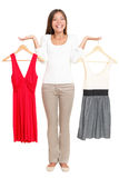 Woman choosing dresses. Woman choosing between dresses and can not make decision. Beautiful Asian / Caucasian woman showing clothes isolated on white background Stock Photos