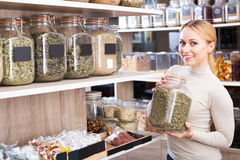 Woman choosing dried herbs Royalty Free Stock Image