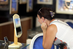 Woman choosing earrings Stock Image