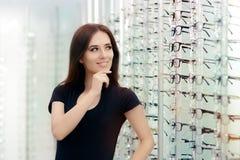 Woman Choosing Eyeglasses Frames in Optical Store Stock Photography