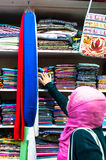 Woman choosing fabrics in Muttrah Souk, Muscat, Oman Middle East Royalty Free Stock Images