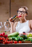 Woman choosing between fast food and healthy vegetables, fruits Stock Images