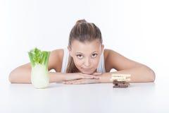 Woman choosing food Stock Photos