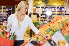 Woman Choosing Fresh Apples In Grocery Store Royalty Free Stock Images