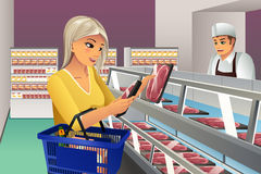 Woman Choosing Frozen Meat. A vector illustration of woman choosing a frozen meat at supermarket Stock Photography