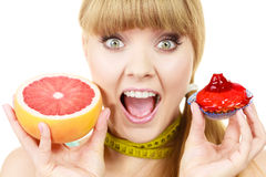 Woman choosing fruit or cake make dietary choice Royalty Free Stock Images