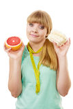 Woman choosing fruit or cake make dietary choice Stock Photography