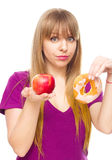 Woman choosing between fruit and sweets Stock Photography