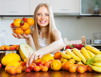 Woman choosing  fruits Stock Image