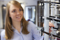 Woman Choosing Glasses In Opticians Royalty Free Stock Image