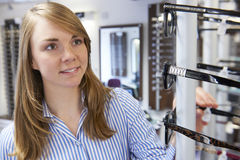 Woman Choosing Glasses In Opticians Royalty Free Stock Photo