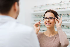Woman choosing glasses at optics store Royalty Free Stock Images