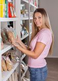 Woman Choosing Groceries In Supermarket Royalty Free Stock Photos