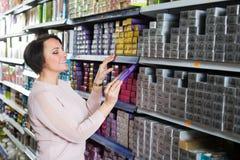 Woman choosing hair dye Stock Photo