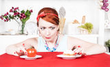 Woman choosing between healthy food and cake Royalty Free Stock Photography