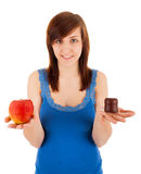 The woman is choosing between healthy and unhealthy Stock Image