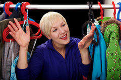 Woman choosing her clothes Royalty Free Stock Photography