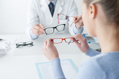 Woman Choosing Her New Glasses Royalty Free Stock Photos