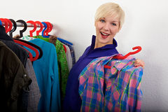 Woman choosing her shirt Royalty Free Stock Photos