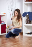 Woman choosing her shoes Stock Photography