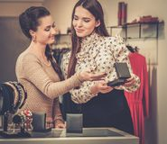 Woman choosing jewellery with shop assistant Royalty Free Stock Photo