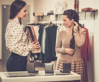 Woman choosing jewellery with shop assistant Royalty Free Stock Image