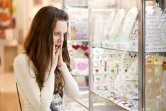 Woman is choosing jewerly Stock Photos
