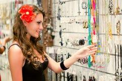 Woman is choosing jewerly Stock Photos
